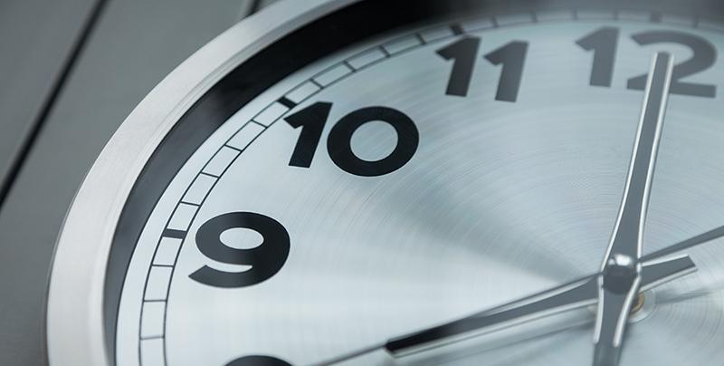 analog clock cropped up close